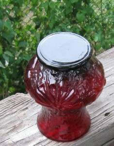 This is a excellent Ruby glass vase A raised flower design Damage free