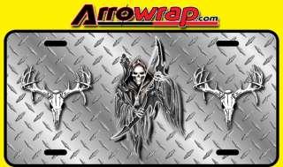 Grim reaper/deer skulls license plate on diamond plate look background