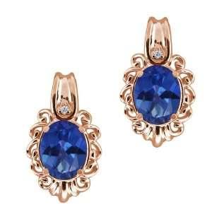 3.22 Ct Oval Sapphire Blue Mystic Topaz and Diamond Gold
