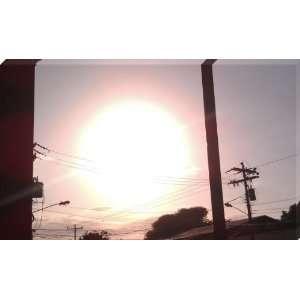Extremely Big Sun Setting   la ceiba, atlantida, Honduras   Wrapped